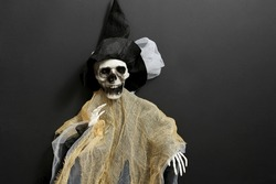 Halloween with a skeleton of a witch. Decorating the interior for the Halloween holiday.