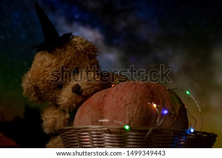Halloween with pumpkins and a teddy bear. The garland glows in different colors, a festive mood. #1499349443