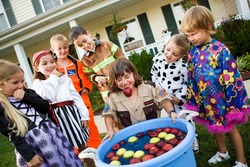 Halloween: Young Girl Gets Soaked Bobbing For Apples At Party