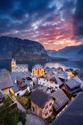 Hallstatt, Austria. Cityscape image of iconic alpine village Hallstatt at dramatic autumn sunrise.