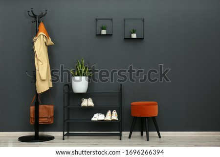 Hallway interior with stylish furniture, clothes and accessories Stockfoto ©