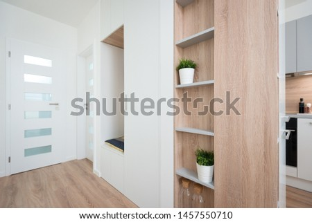 Hallway next to kitchen in a contemporary house  #1457550710