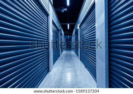 Photo of  Hallway with blue storage units. Blue phantom colors
