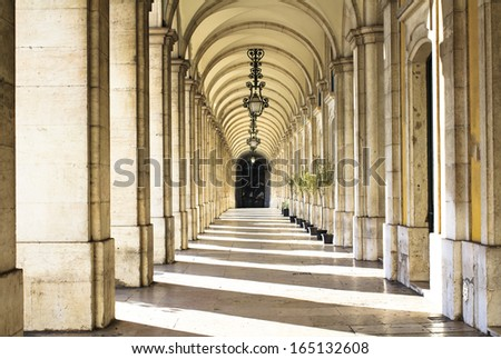 Hallway with columns surrounding the Commerce Square in Lisbon, Portugal