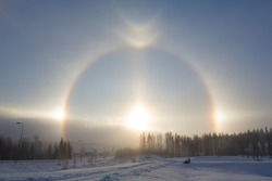 Halo effect in Finland during a winter morning. Sunny and glittering light. Cold weather.