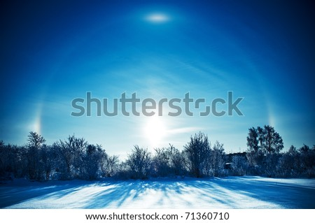 Halo optical phenomenon in winter day