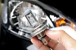 halogen light bulb H4 over black car