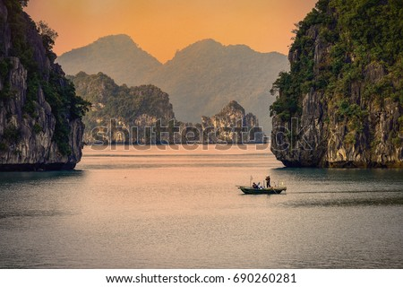 Halong bay boats,Sunset at Ha Long Bay scenic view , Hanoi, Vietnam #690260281