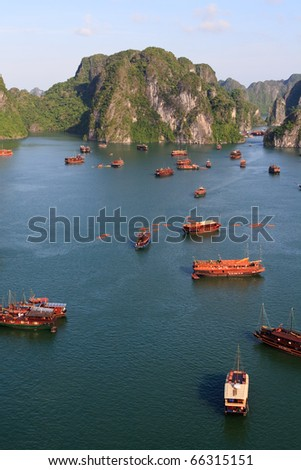 Halong Bay junk boats gather for the evening, Vietnam, Asia