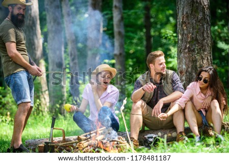 Halt for snack during hiking. Camping and hiking. Company friends relaxing and having snack picnic nature background. Great weekend in nature. Company hikers relaxing at picnic forest background.