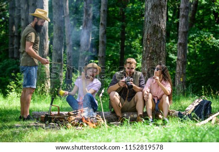 Halt for snack during hiking. Company friends relaxing and having snack picnic nature background. Camping and hiking. Company hikers relaxing at picnic forest background. Great weekend in nature.