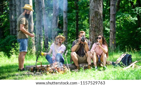 Halt for snack during hiking. Company friends relaxing and having snack picnic nature background. Camping and hiking. Company hikers relaxing at picnic forest background. Spend great time on weekend.