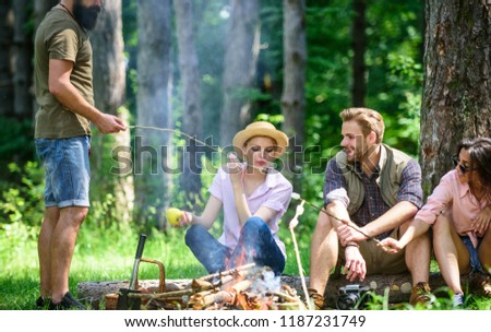 Halt for snack during hiking. Company friends relaxing and having snack picnic nature background. Camping and hiking. Great weekend in nature. Company hikers relaxing at picnic forest background.