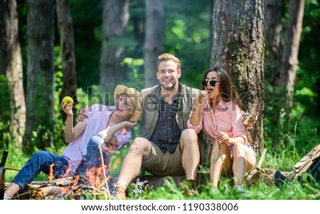 Halt for snack during hiking. Company hikers relaxing at picnic forest background. Camping and hiking. Relax and fun in nature. Company friends relaxing and having snack picnic nature background.