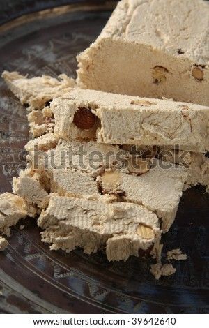 Halva with almonds, made of crushed sesame seeds and honey