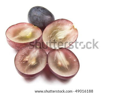 Halved and whole red grapes