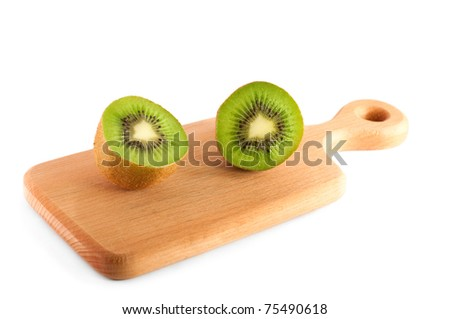 halves of kiwi on the cutting board isolated over white