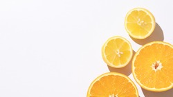 Halves of orange, lemon on white background. Top view. Composition of juicy citruses with place for text. Concept of diet, health, taste, food. Isolated. Bright light. 9x16. Copy space