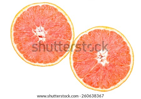 Halves of red oranges isolated on white  #260638367