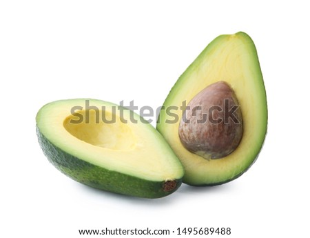 Halves of ripe avocado with pit on white background Foto stock ©