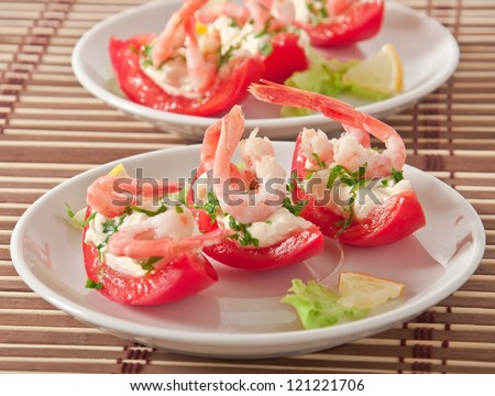 Halves of tomatoes filled with shrimp cocktail