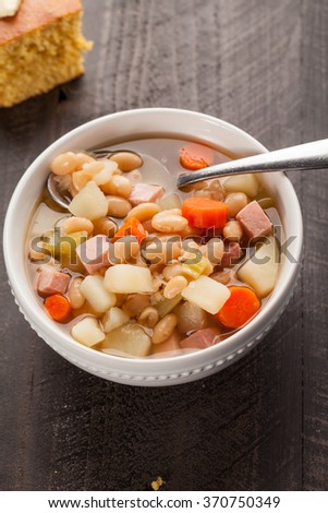 Ham and bean soup angled view with corn bread