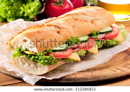 Ham And Cheese Salad Submarine Sandwich From Freshly Cut Baguette.