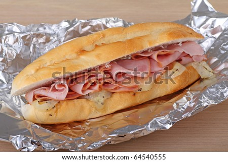 Ham and cheese sandwich baked in aluminum foil
