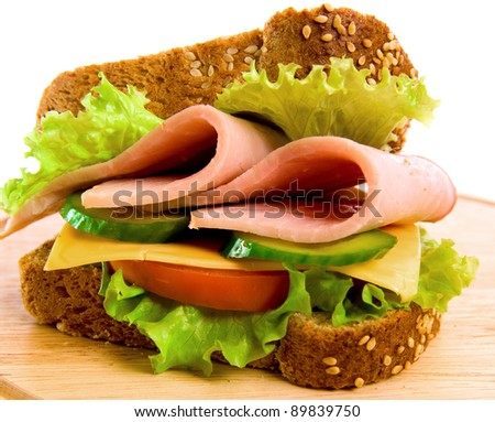 Ham and cheese sandwich with lettuce and tomatoes, isolated on white