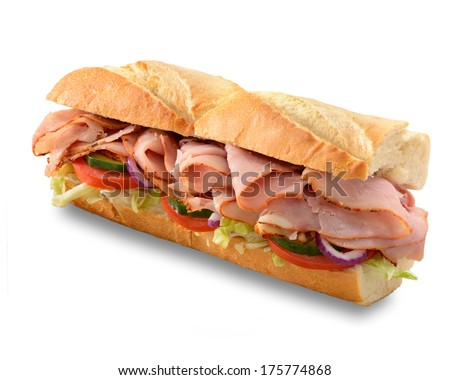 Ham and salad submarine sandwich from freshly cut baguette. Isolated on white with small shadow.