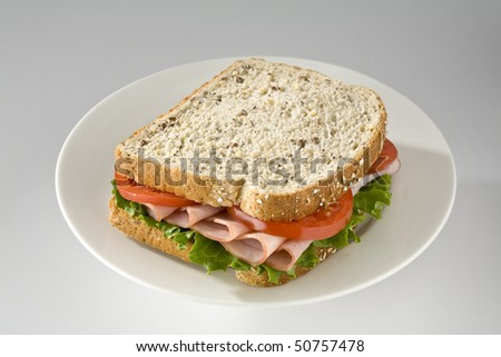 Ham and tomato sandwich on wholegrain bread