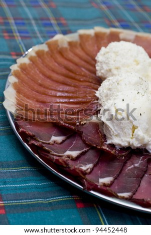 ham, cheese and dry pork served as an appetizer