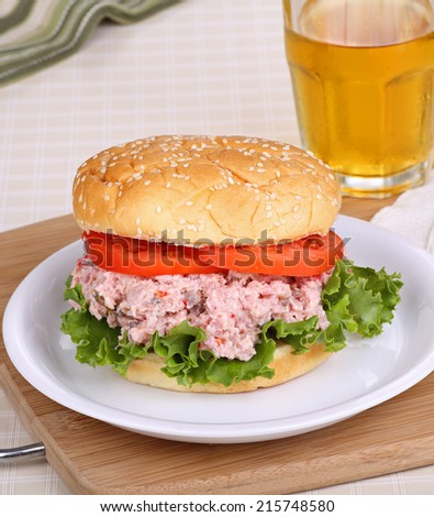 Ham salad on a bun with lettuce and tomato