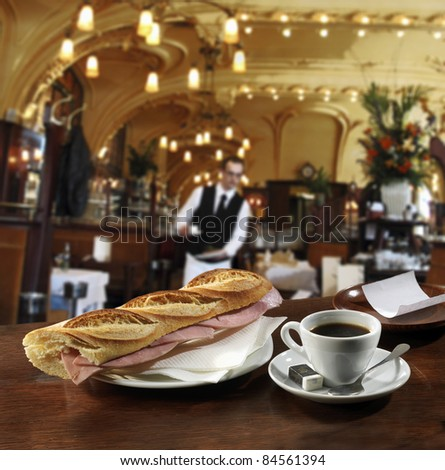 Ham sandwich and a cup of coffee on the bar in a Brasserie