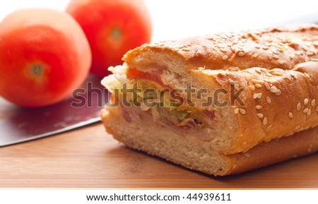 Ham Sandwich on White Break with Tomato and Knife