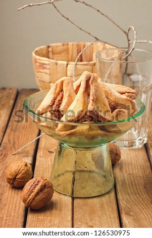 Hamantaschen cookies for Jewish festival of Purim on wooden table