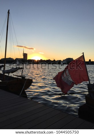 hamburg flag waving in front of the Alster on a warm summer night, Hamburg, Germany #1044505750
