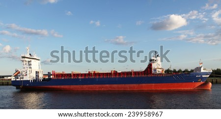 HAMBURG, GERMANY - JUNE 25, 2014: Transport ship Elan on the river Elbe in the harbor of Hamburg.  Hamburg has the most important international harbor of Germany