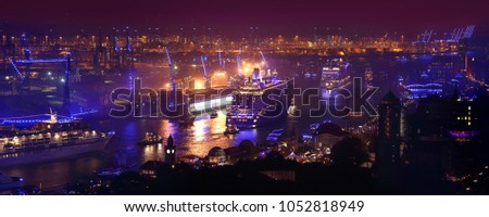Hamburg, Germany: 3 large cruise ships leaving Hamburg during Hamburg Cruise Days 2015. The Hamburg harbour is at this point in time illuminated by blue light. Picture taken from St. Michaelis church.