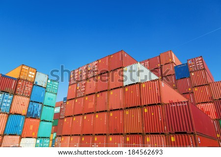 HAMBURG, GERMANY - MARCH 10: container in the container harbor on March 10, 2014 in Hamburg. The harbor of Hamburg is the largest sea harbor in Germany and under the 20 largest harbors of the world.