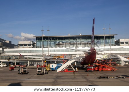 HAMBURG, GERMANY - SEP 3: Aircraft at the finger in the new Terminal 2 on September 3, 2012 in Hamburg, Germany. Terminal 2 was completed in 1993 and houses Lufthansa and other Star Alliance partners.