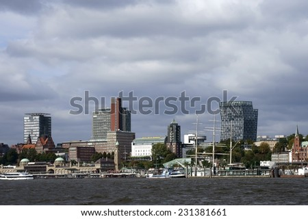 HAMBURG, GERMANY - SEPTEMBER 22: Modern Architecture and the harbor promenade of the Harbor City on September 22, 2014 in Hamburg. / Modern architecture in Hamburg