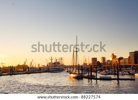Hamburg harbor with skyline, ships and a clear sky at sunset