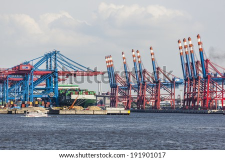 HAMBURG - JULY 5: Container ship in container harbor with tall cranes in Hamburg Harbor, Germany on July 5, 2013
