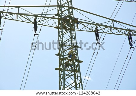 HAMBURG - JUNE 28. Workers in the maintenance of a power pole in Hamburg on June 28, 2011. The pylons was, because of the conversion to renewable energy, re-examined.