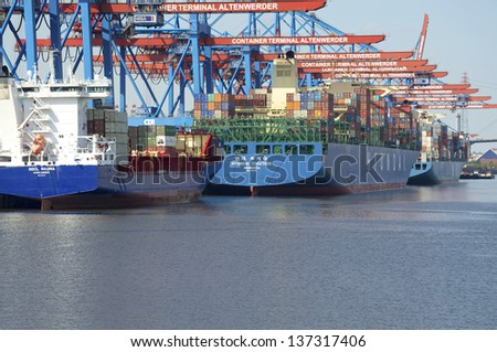 HAMBURG - May 03. Container ships at the quay in the harbor of Hamburg on May 03, 2013. Hamburg is the most important harbor for international trade in Germany. - stock photo