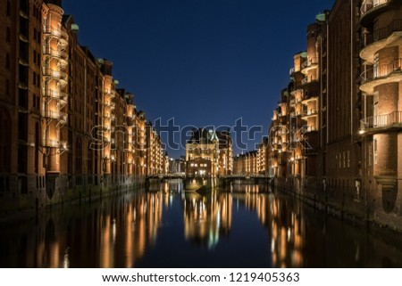 Hamburg Speicherstadt at blue hour. The blue sky and the color of the lights is a nice interaction.  #1219405363