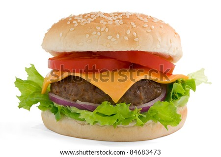 Hamburger, beef cheese tomato and red onion on a sesame bun. With clipping path. - stock photo
