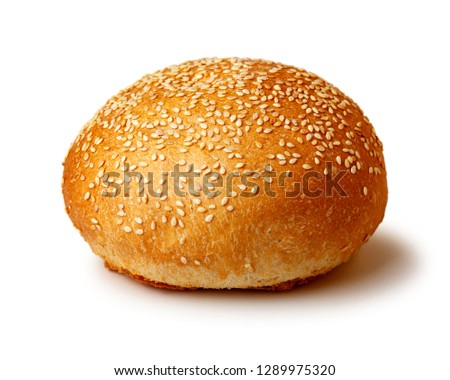 Hamburger bun with sesame  seeds. Fast food. Isolated on white background.