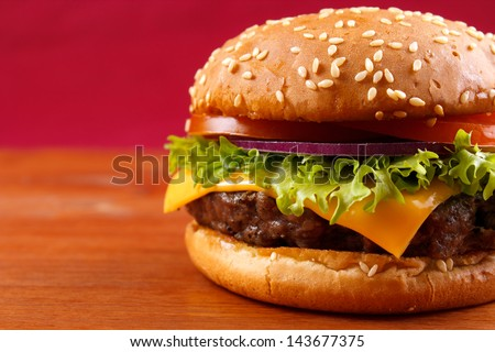 Hamburger closeup on red background with copyspace